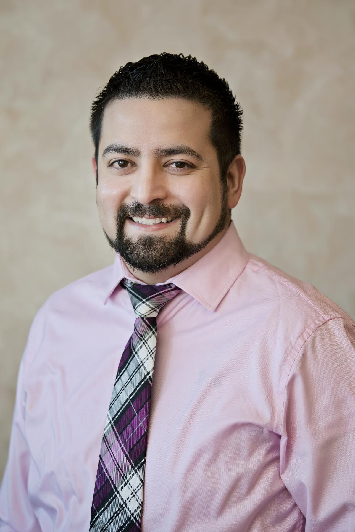Refugio Alvarez, MD